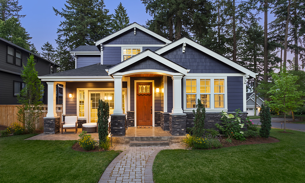 Exterior of House Painted with Indigo SW 6531 on the body, extra white SW 7006 on the trim and Chinese red SW 0057 on the front door